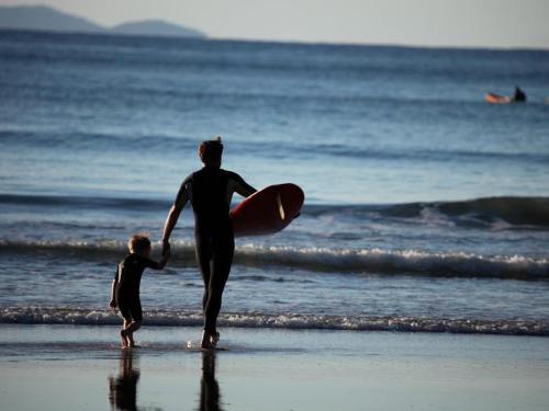 image of father and child surfing, for Casa Ojai blog article